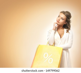 Beautiful woman with the bright shopping bags