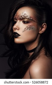 Beautiful woman with bronse futuristic make up