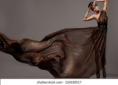 beautiful woman in brown dress