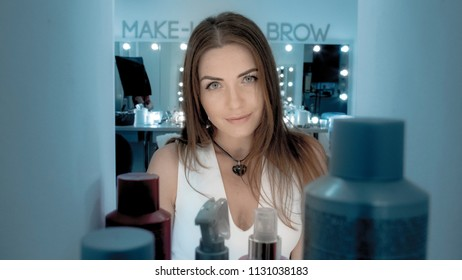 Beautiful woman with brown hair and professional makeup