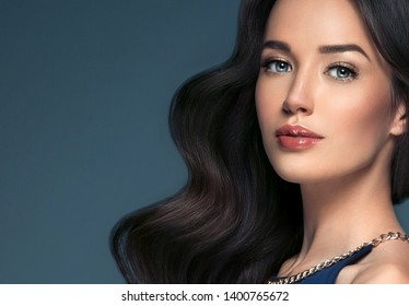 Beautiful woman brunette beauty hair and makeup face closeup