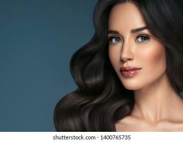 Beautiful woman brunette beauty hair and makeup face closeup