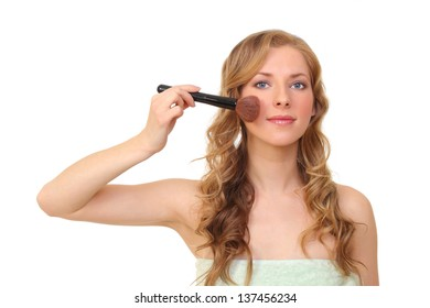 beautiful woman with a brush.on a white background
