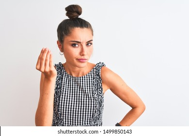 Beautiful woman with bun wearing casual dresss standing over isolated white background Doing Italian gesture with hand and fingers confident expression