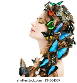 beautiful woman with butterflies in her hair