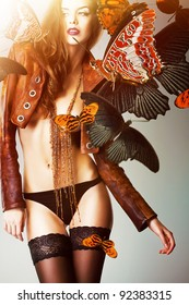 beautiful woman with butterflies on shoulder
