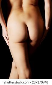 Beautiful woman buttocks over dark background.