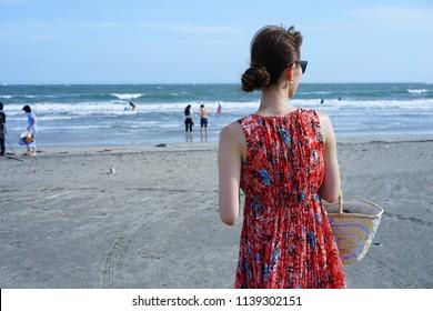 A beautiful woman by ocean.