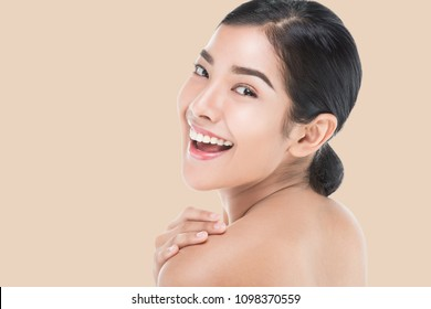 Beautiful woman cares for the skin face - posing at studio isolated on white with clipping path,asian Beauty.