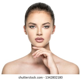 Beautiful woman cares for the skin face -  isolated on white background.  Front portrait of pretty woman.