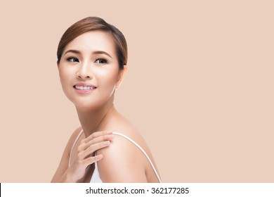 Beautiful woman cares for the skin face - posing at studio isolated with clipping path, Asian Beauty.