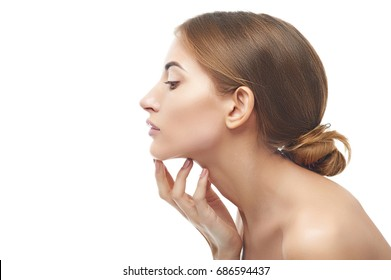Beautiful woman cares for the skin of neck, isolated on white background, skincare concept