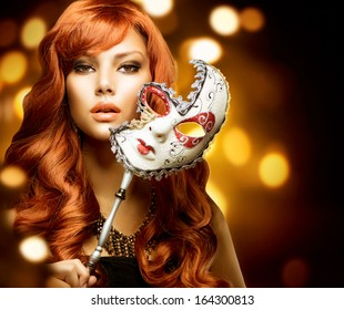 Beautiful Woman with the Carnival mask. Holiday Fashion Girl Portrait. Beauty Hairstyle and Makeup. Make up. Celebrating Glamorous Lady