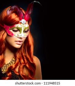 Beautiful Woman in a Carnival mask. Isolated on Black