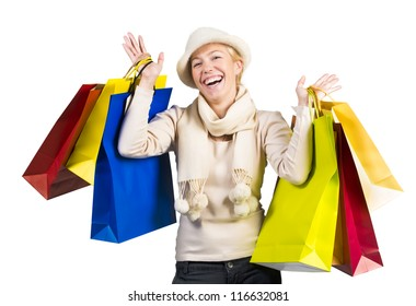 Beautiful woman carrying a lot of colorful shopping bags