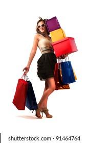 Beautiful woman carrying many shopping bags