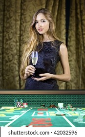 beautiful woman in a casino gambling on the roulette