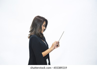 Beautiful woman casually dressed isolated on a white background using a computer tablet