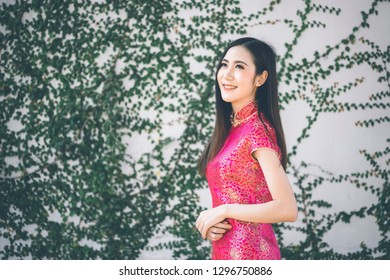 Beautiful woman with cheongsam traditional Chinese dress on Chinese new year.