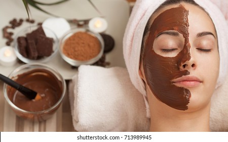 Beautiful woman with chocolate mask on her face.