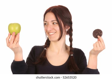 beautiful woman choosing between apple and chocolate cookies on white background