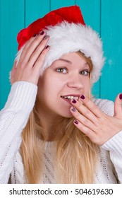Beautiful woman in Christmas cap. blue background