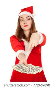 Beautiful woman in christmas costume holding dollars isolated on white (focus on dollars)