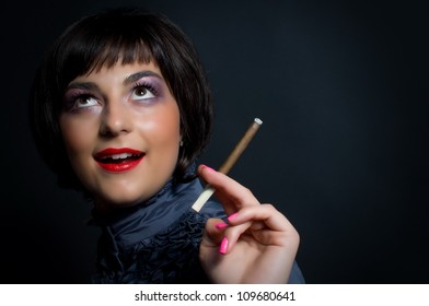 Beautiful woman with cigarette in vintage image