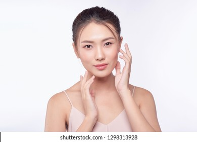 Beautiful woman with clean skin, natural make-up isolated white background