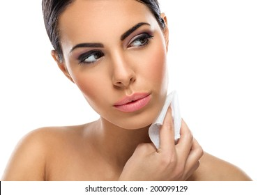 beautiful woman cleaning skin with wet tissues