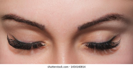 A beautiful woman with closed eyes. Close up shot