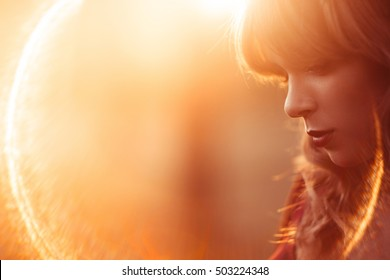 Beautiful woman with closed eyes profile, lens flare, free space. Fashion, art photography, beauty concept