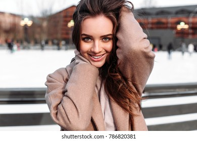 Beautiful woman closeup winter cold weather outdoor street portrait
