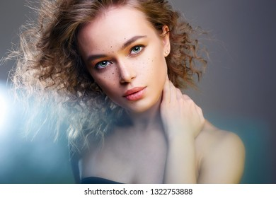 Beautiful woman in color Lights. amazing curly girl with make-up. beauty fashion portrait. frizzle hair