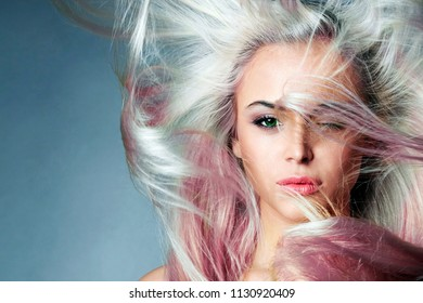 beautiful woman with Colorful hair. Rainbow Hairstyles. Beauty Fashion Model with Colorful Dyed Hair