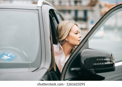 Beautiful woman coming out of the car
