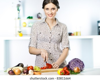 Beautiful woman cooking healthy food in the kitchen