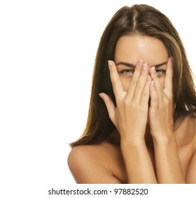 beautiful woman covering her face with her hands on white background