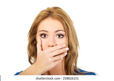 Beautiful woman covering her mouth.
