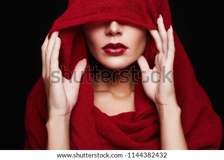 beautiful woman covers her face with a colored hood. red lips make-up girl 2def1e47775