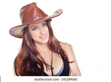 Beautiful woman with cowboy hat and brown hairs.