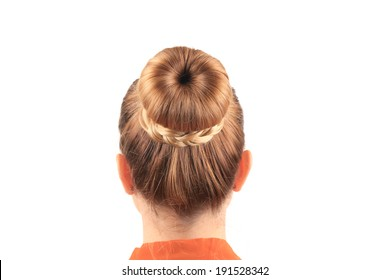 Beautiful woman with creative elegant hair bun. Isolated on a white background.