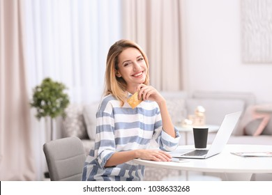 Beautiful woman with credit card and laptop at home. Online shopping concept