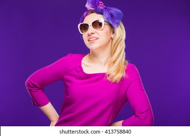 beautiful woman in crimson dress on a blue background