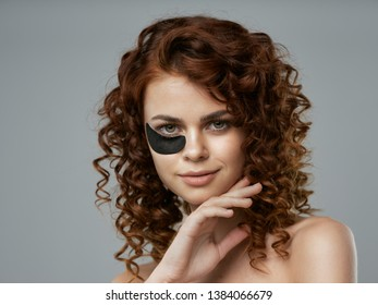 Beautiful woman with curly hair collagen cosmetology skin care gray background