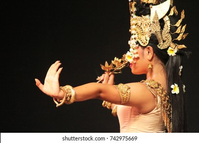 Beautiful woman dancer with golden ornaments on a typical Cambodian Dance in Phnom Penh, Cambodia.