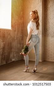 Beautiful woman dancer Kizomba and Bachata, beautiful back in stylish jeans