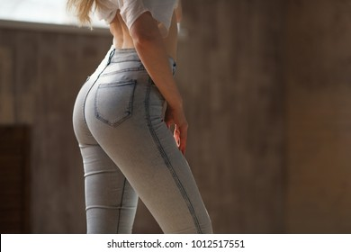Beautiful woman dancer Kizomba and Bachata, beautiful back in stylish jeans