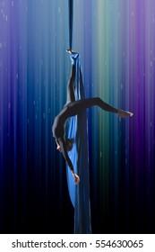 beautiful woman dancing with aerial silk