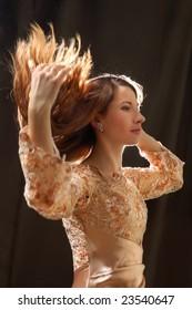 Beautiful woman dancing with hair flying